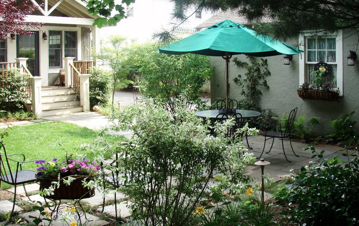 Hidden garage side garden patio.
