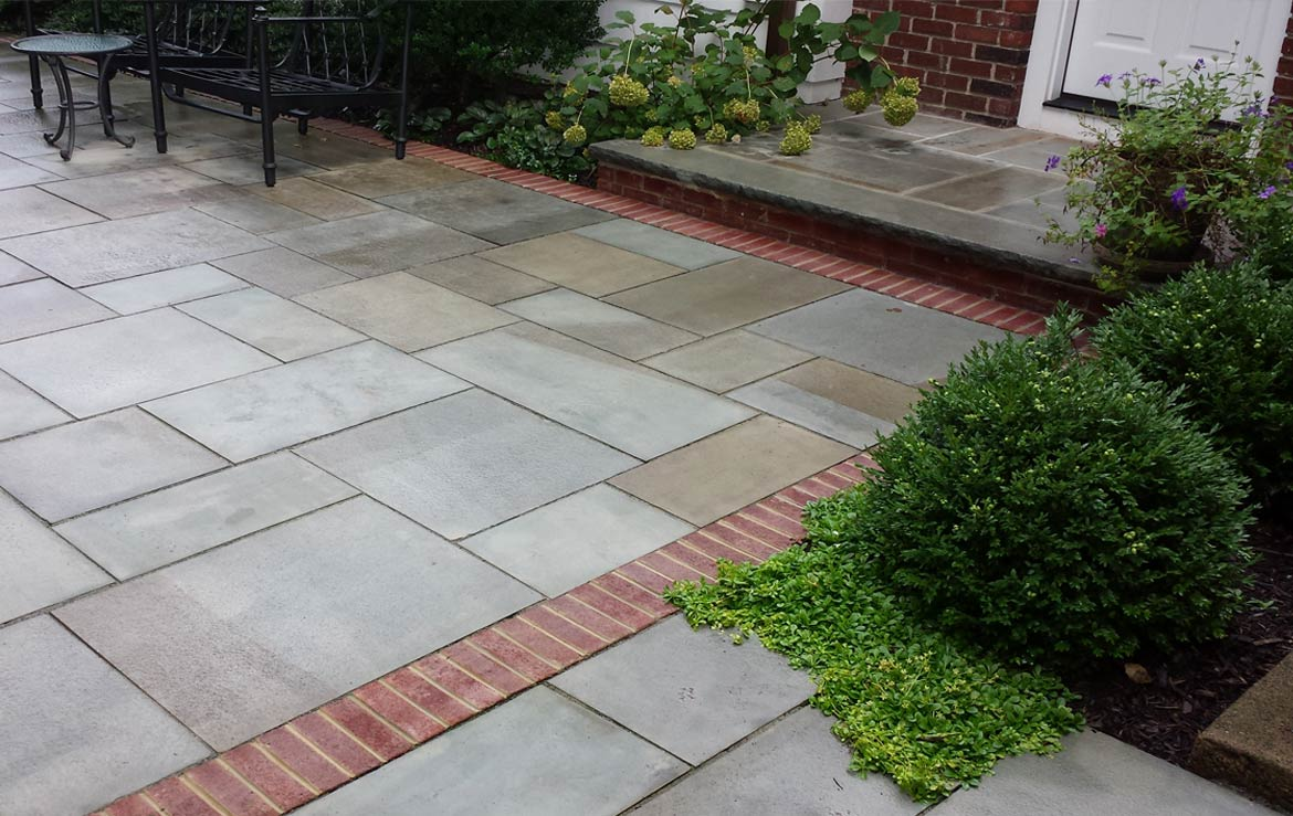 Bluestone patio and landing with brick details.